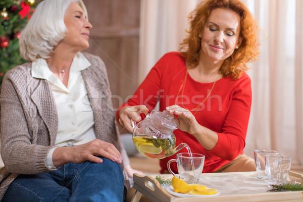 Woman pouring tea Stock photo © LightFieldStudios