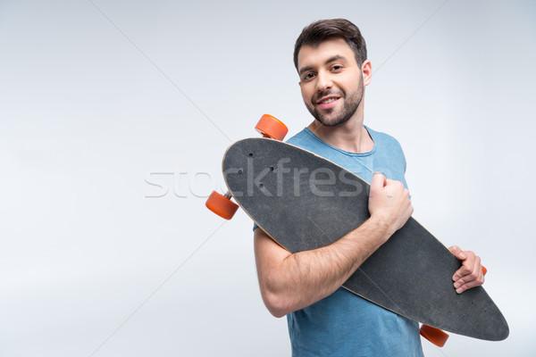 Portré mosolyog férfi tart gördeszka kezek Stock fotó © LightFieldStudios