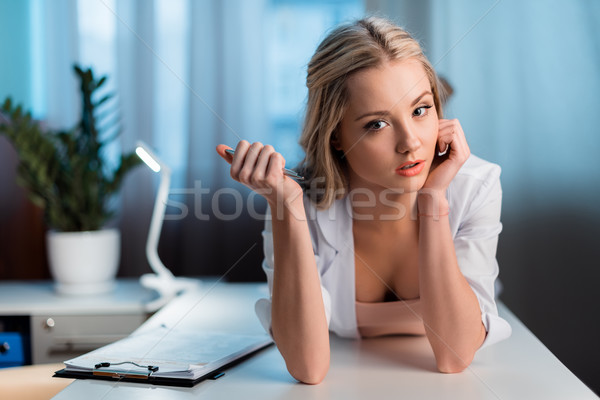 portrait of pensive professional doctor lying on table in cabinet Stock photo © LightFieldStudios