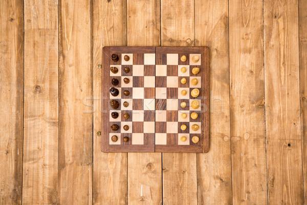 Superior vista tablero de ajedrez piezas marrón Foto stock © LightFieldStudios