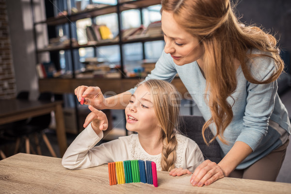 Mother and daughter playing with plasticine Stock photo © LightFieldStudios