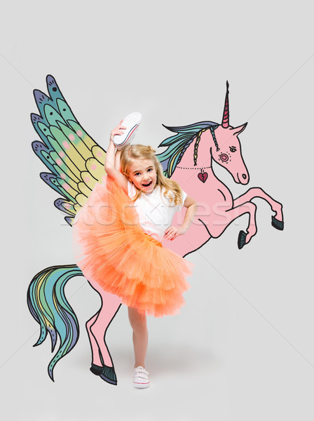 girl with hand drawn colorful unicorn Stock photo © LightFieldStudios