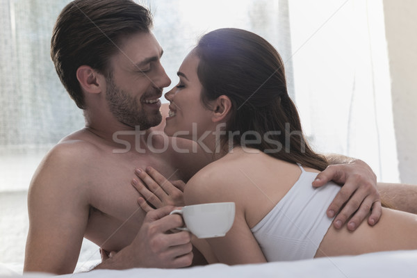couple cuddling in bed at morning Stock photo © LightFieldStudios