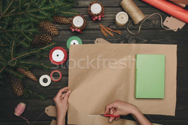 woman wrapping christmas gift Stock photo © LightFieldStudios
