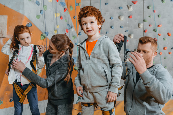 Parent securing children in harnesses Stock photo © LightFieldStudios