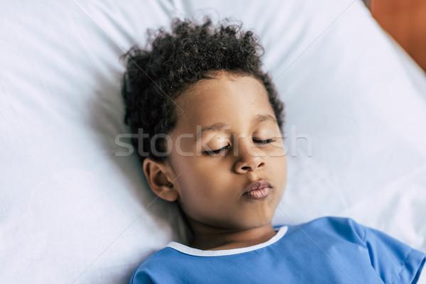 african american boy sleeping in bed Stock photo © LightFieldStudios