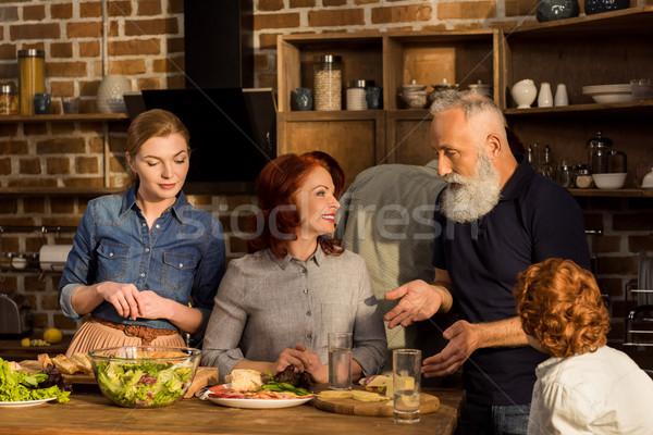 Boldog családi portré család párbeszéd konyha otthon Stock fotó © LightFieldStudios