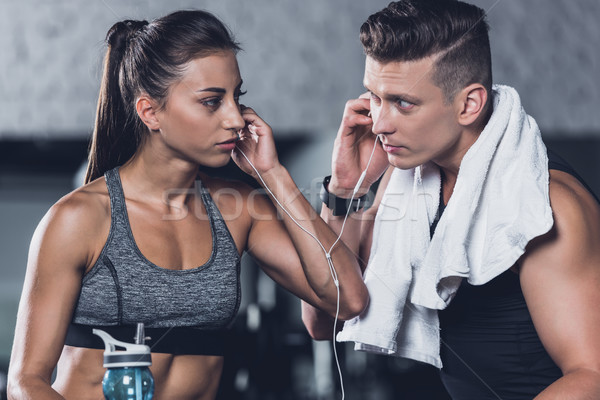 couple listening music in gym Stock photo © LightFieldStudios