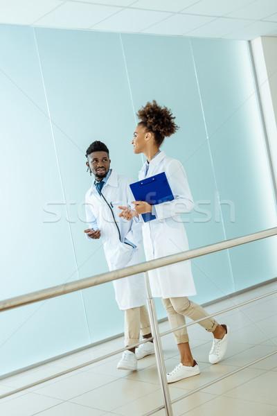 Orvosok sétál kórház kettő labor lefelé Stock fotó © LightFieldStudios