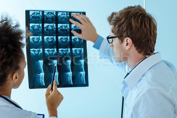 Orvosok megvizsgál röntgen kettő fiatal fénykép Stock fotó © LightFieldStudios