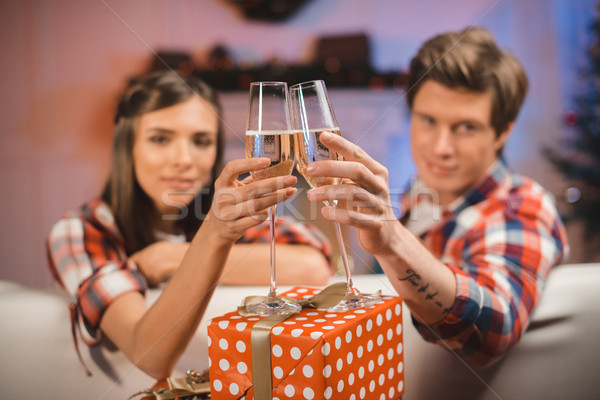 couple clinking glasses of champagne on christmas Stock photo © LightFieldStudios