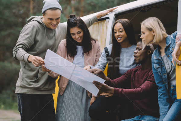 Stock photo: friends looking at map