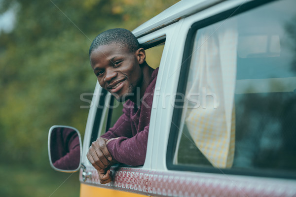 smiling man in retro minivan Stock photo © LightFieldStudios