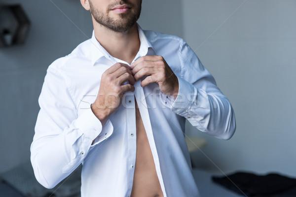 Adam yukarı gömlek atış genç yakışıklı adam Stok fotoğraf © LightFieldStudios