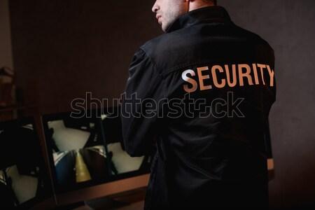 Adam evrak çantası atış takım elbise gözlük Stok fotoğraf © LightFieldStudios