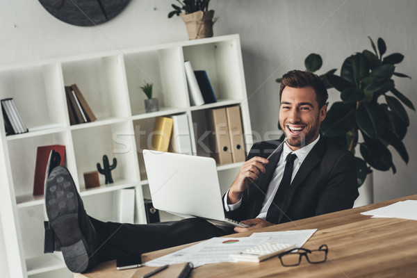 Stock photo: businessman working with laptop