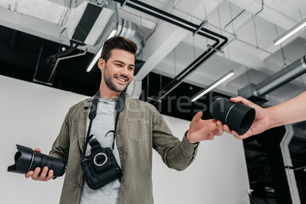 photographer with camera and lenses Stock photo © LightFieldStudios