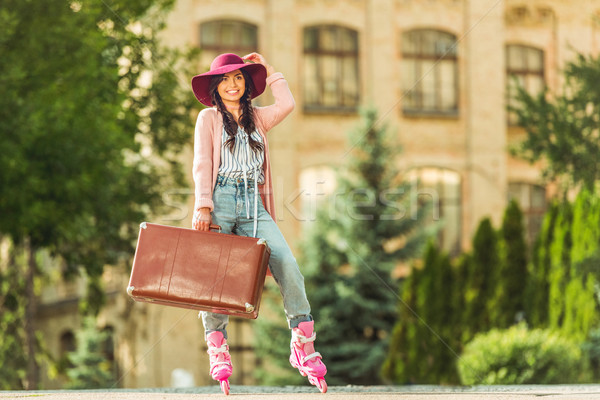 girl in roller skates with suitcase Stock photo © LightFieldStudios