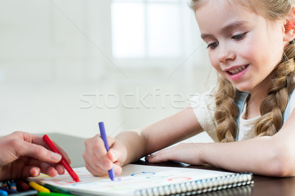 Happy mother and daughter drawing at home Stock photo © LightFieldStudios