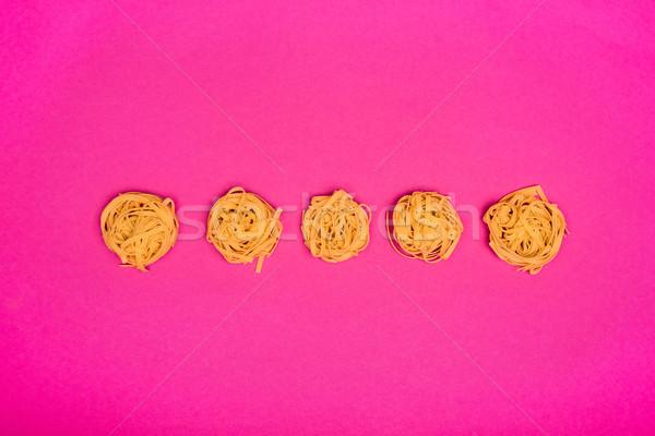 пасты сырой розовый фон приготовления Сток-фото © LightFieldStudios