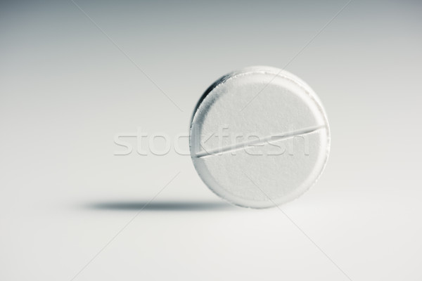 Close-up view of round white medical tablet on grey, medicine and healthcare concept    Stock photo © LightFieldStudios