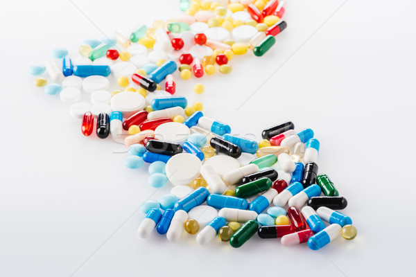 close up view of arrow made of medical pills on white Stock photo © LightFieldStudios