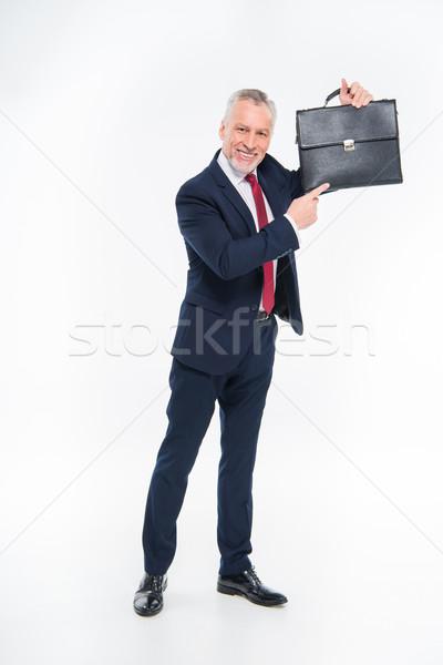 бизнесмен указывая портфель улыбаясь белый работу Сток-фото © LightFieldStudios