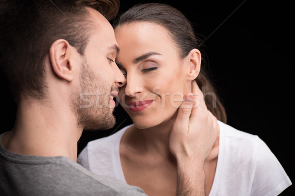 portrait of happy couple in love with closed eyes on black Stock photo © LightFieldStudios