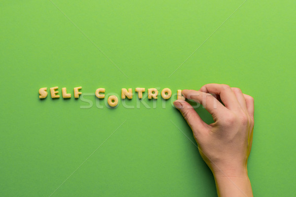 self controt concept,  person making words of cookies isolated on green. healthy lifestyle and healt Stock photo © LightFieldStudios