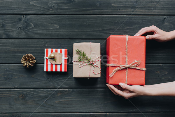 woman placing christmas gift in row Stock photo © LightFieldStudios