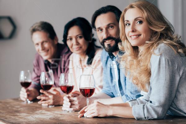Arkadaşlar içme şarap mutlu orta yaşlı gülen Stok fotoğraf © LightFieldStudios