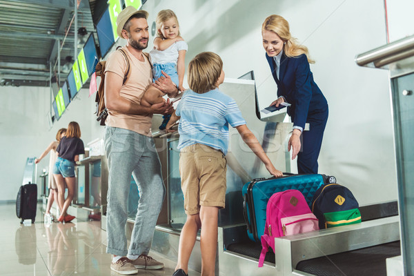 family at check in desk in airport Stock photo © LightFieldStudios