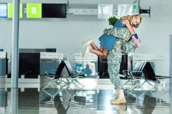 wife meeting soldier at airport Stock photo © LightFieldStudios