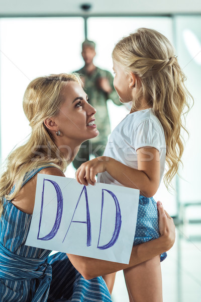 mother and daughter meeting father at airport  Stock photo © LightFieldStudios