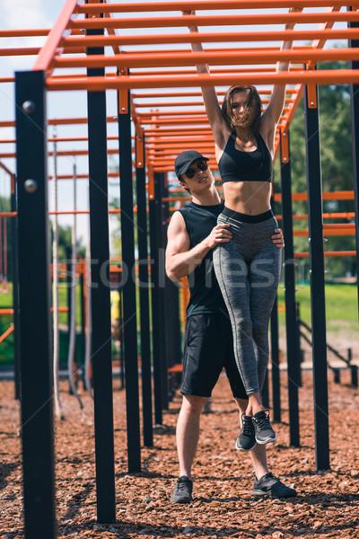 trainer helping woman Stock photo © LightFieldStudios