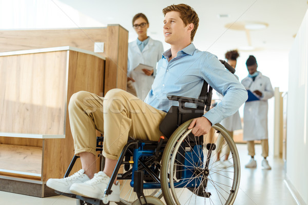 man in wheelchair at hospital corridor Stock photo © LightFieldStudios