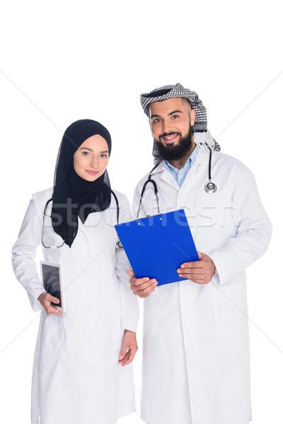 счастливым мусульманских врачи изолированный глядя камеры Сток-фото © LightFieldStudios