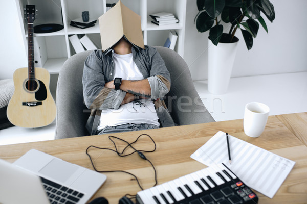 sound producer sleeping with magazine on face Stock photo © LightFieldStudios