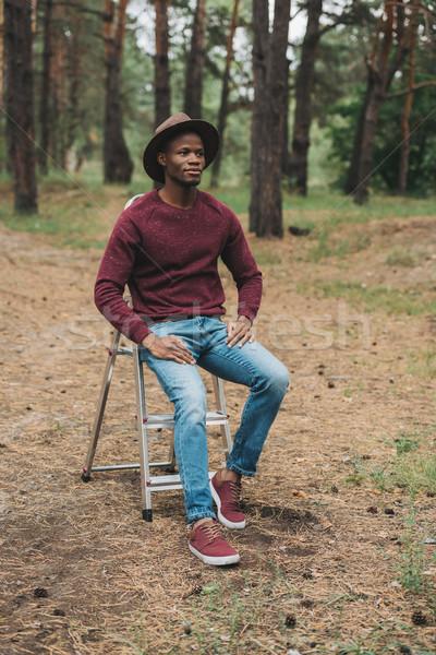 stylish afro man in hat  Stock photo © LightFieldStudios