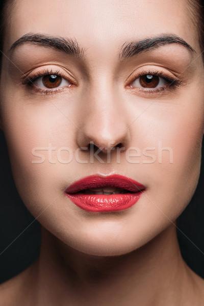 Fiatal nő piros ajkak portré fiatal gyönyörű nő fényes Stock fotó © LightFieldStudios