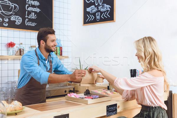 waiter giving take away food to client Stock photo © LightFieldStudios