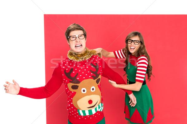 couple in christmas costumes having fun Stock photo © LightFieldStudios