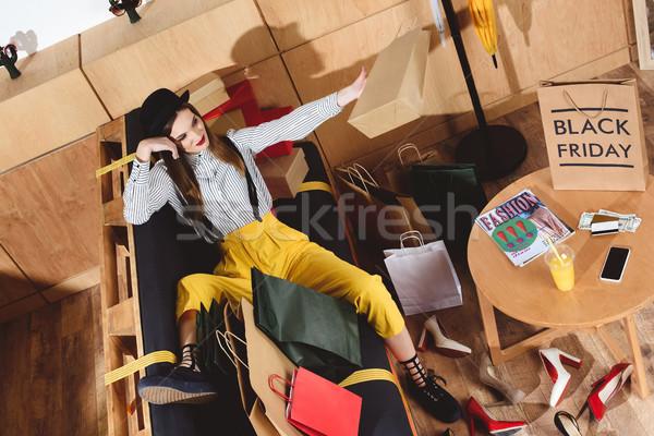 Kız black friday alışveriş mutlu kız oturma Stok fotoğraf © LightFieldStudios