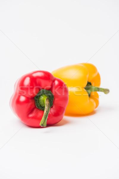 Piros citromsárga harang paprikák fektet fehér Stock fotó © LightFieldStudios
