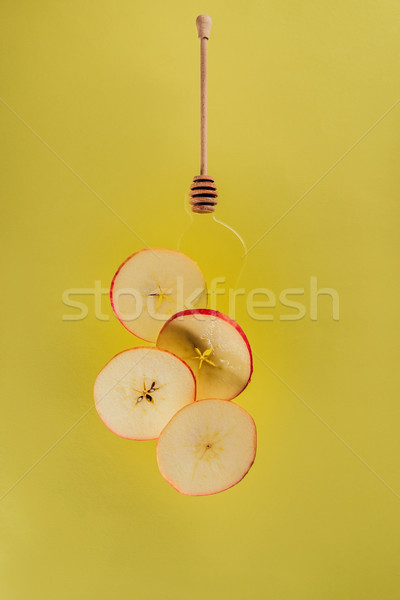 close up view of levitating pieces of apple and honey Stock photo © LightFieldStudios