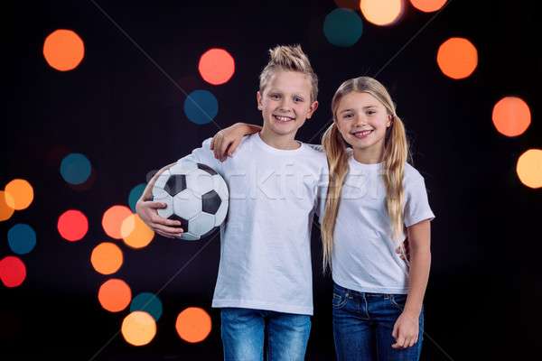 Bruder Schwester posiert Fußball Vorderseite Ansicht Stock foto © LightFieldStudios