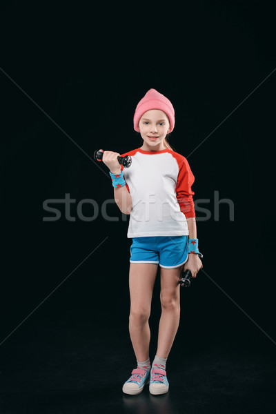 girl training with dumbbells isolated on black. active kids isolated concept  Stock photo © LightFieldStudios