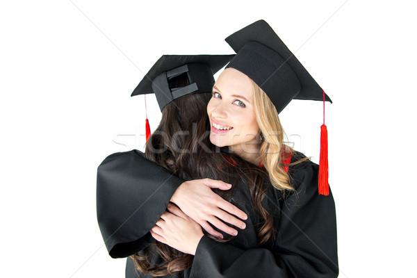 Aantrekkelijk gelukkig studenten afstuderen geïsoleerd Stockfoto © LightFieldStudios