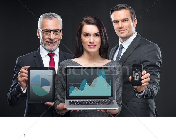 Business people holding digital devices  Stock photo © LightFieldStudios