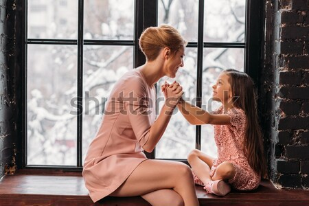 Nő flörtöl férfi iroda fiatal nő ül Stock fotó © LightFieldStudios